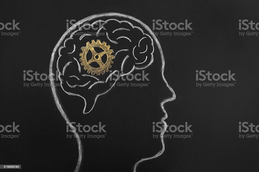 Head With Gears on chalkboard background. stock photo