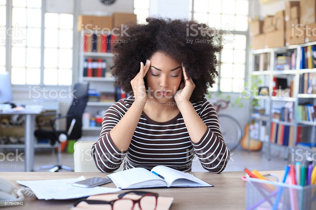 Headache at the office stock photo