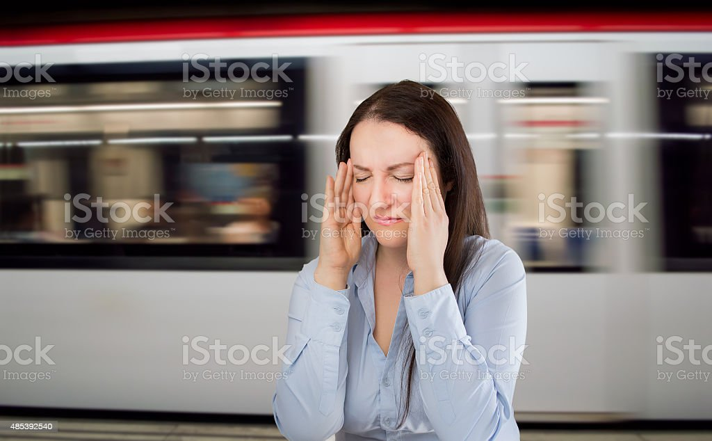 headache at the subway station stock photo
