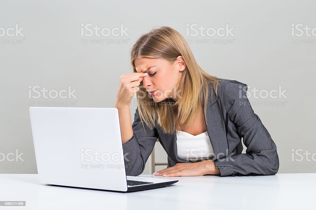 Headache at work stock photo