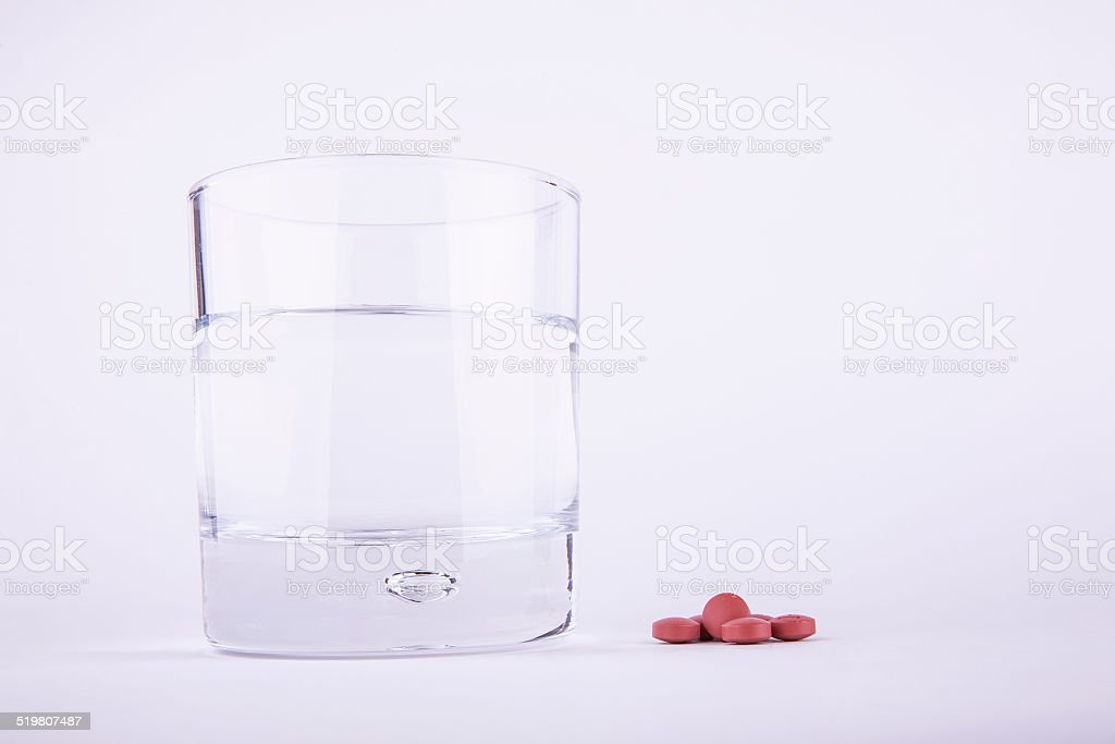 Headache Relief Brown Pills and Water stock photo