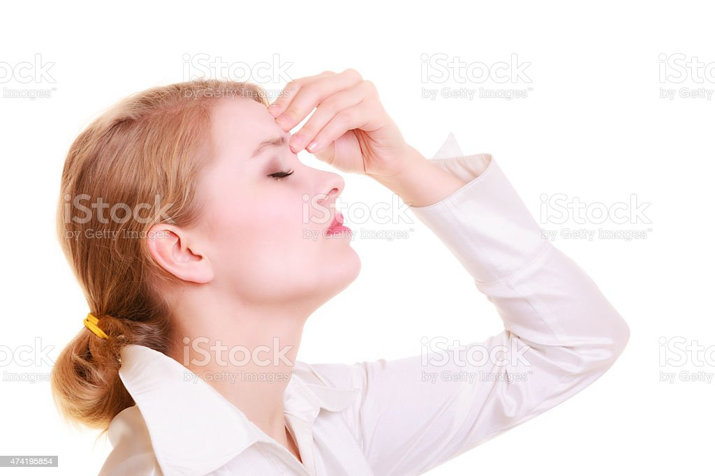 Headache. Woman suffering from head pain isolated. stock photo