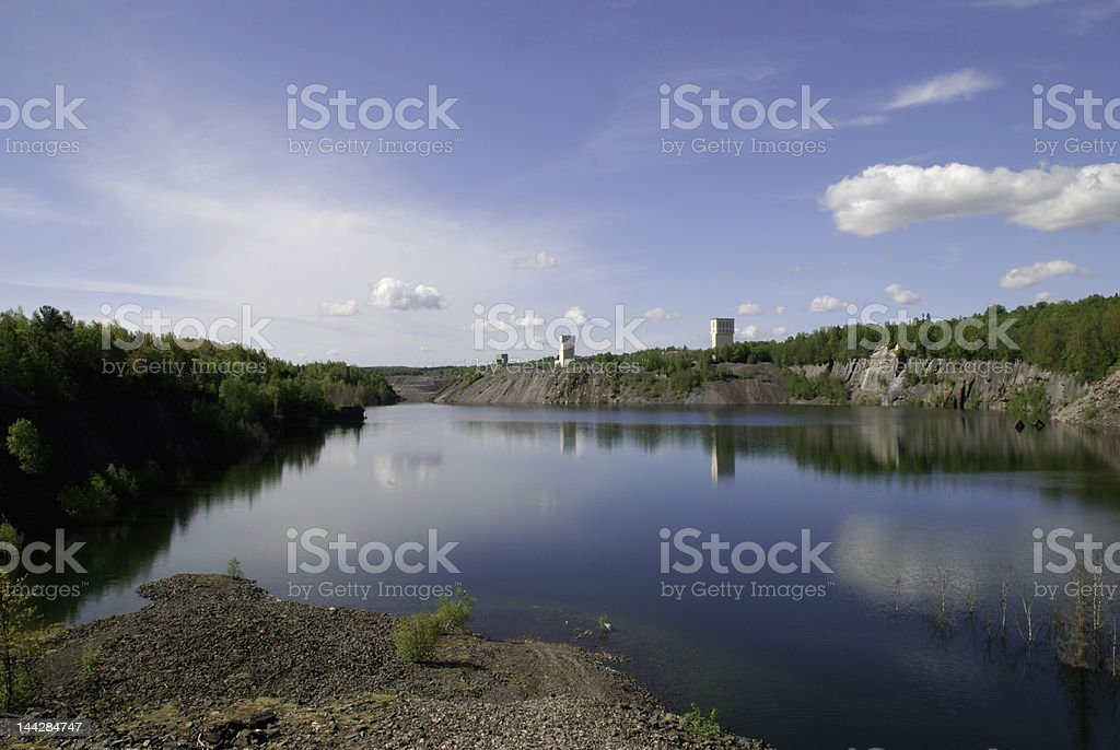 Headframe, Artificial lake caused by mining stock photo