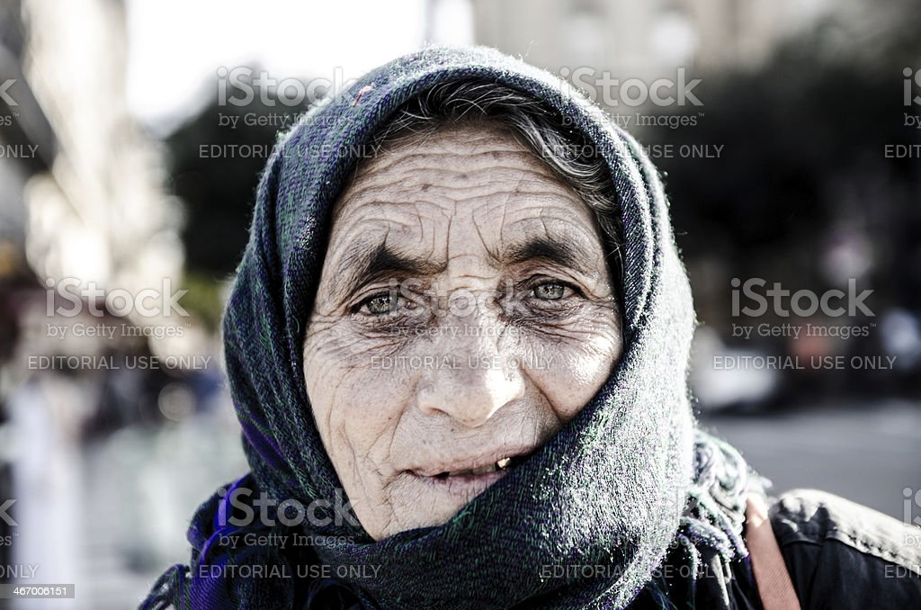 Headhot of woman gipsy wearing a scarf on her head stock photo