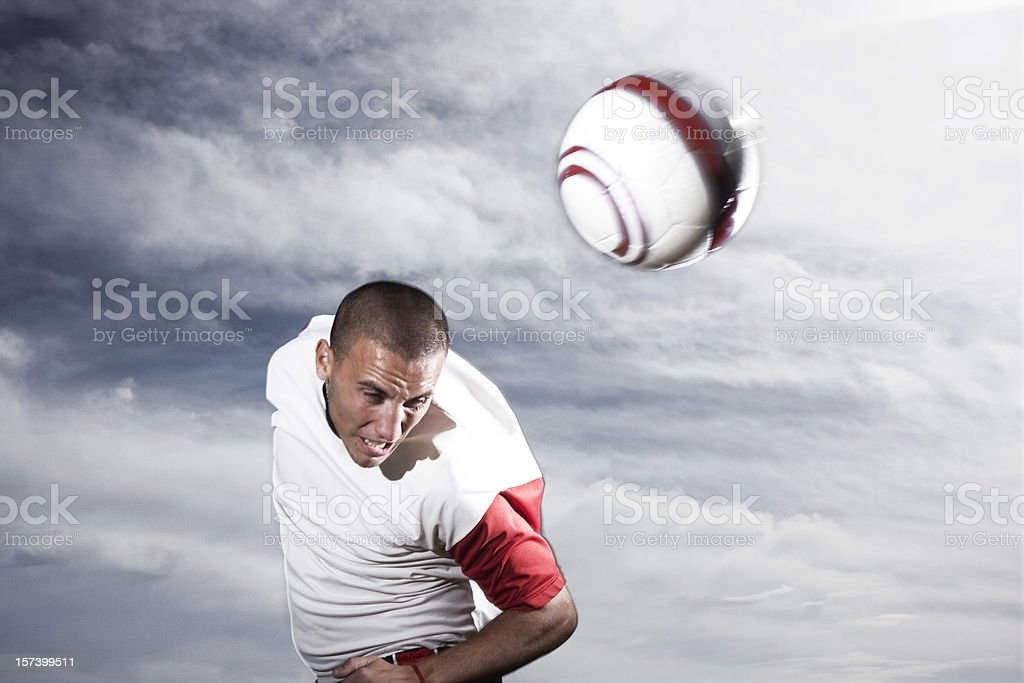 Heading a ball extreme stock photo