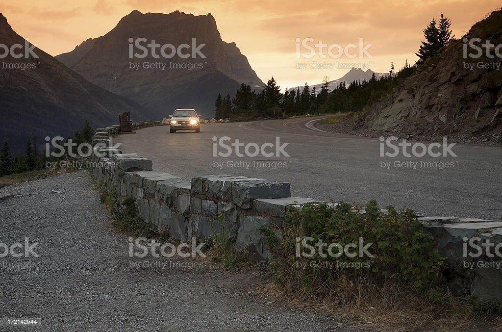 Heading for home - sunset on a mountain road royalty-free stock photo