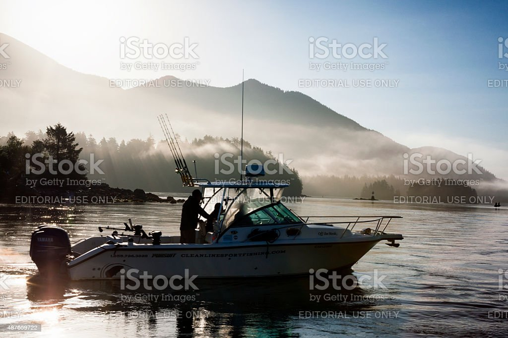 Heading out Fishing at Sunrise in Tofino, British Columbia, Canada stock photo