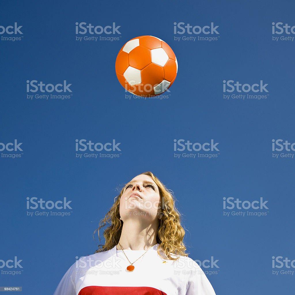 heading the soccer ball royalty-free stock photo
