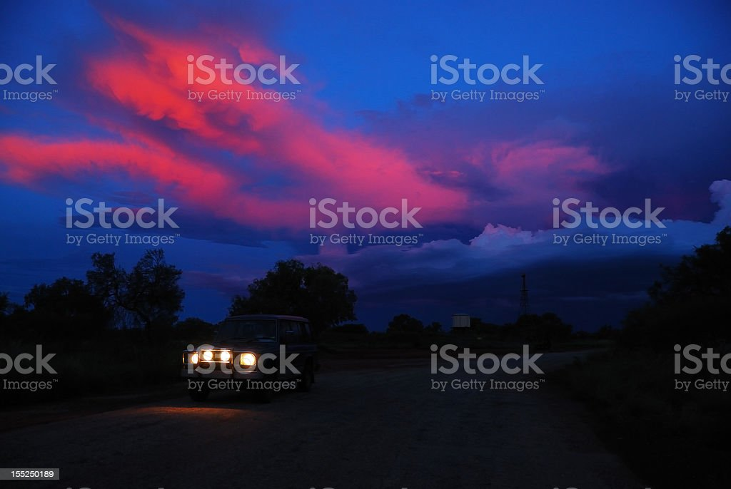 Headlamps Of Car In Dark With Colorful Sky royalty-free stock photo