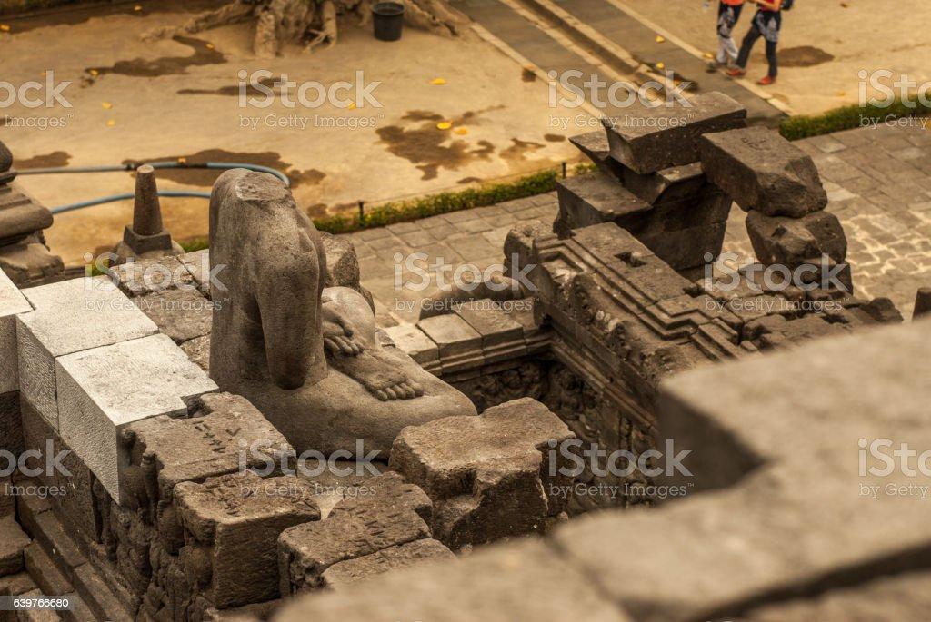 Headless Buddha and surroundings, disenchanted a bit stock photo