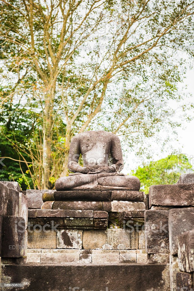 Headless Buddha Sculture in Ancient Indonesian UNESCO Sewu Temple Java stock photo
