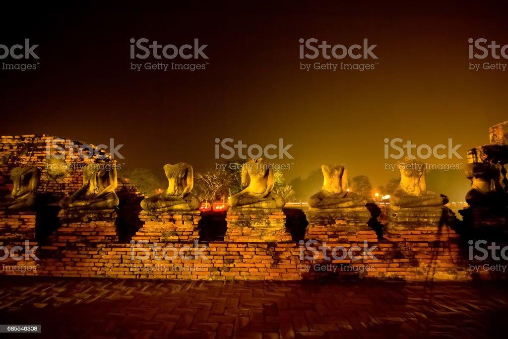 Headless buddha statues at Chai Watthanaram Temple stock photo