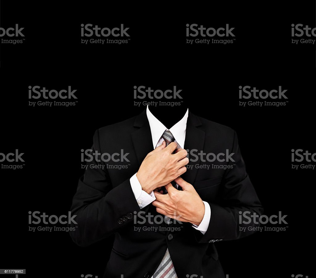 Headless businessman in black suit, with copy space stock photo