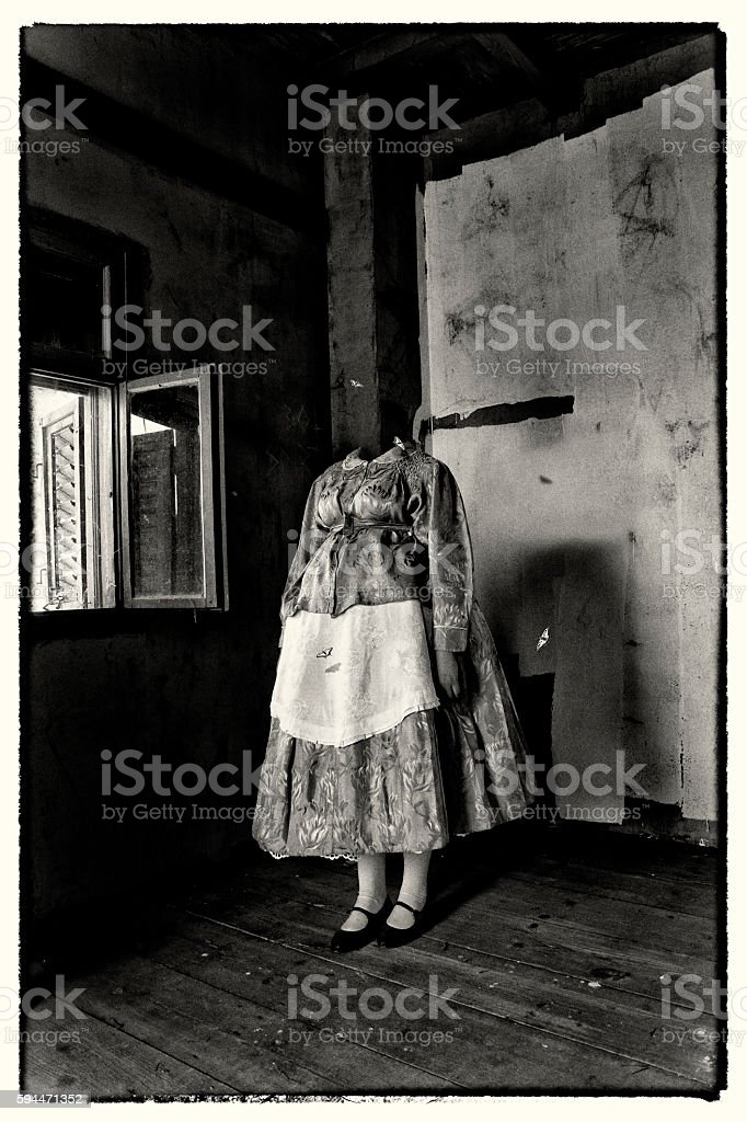 Headless woman wearing traditional dress. Mixed media artwork. stock photo