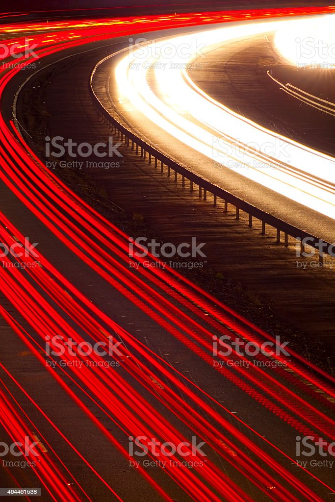 Headlight and tail light trails at night stock photo