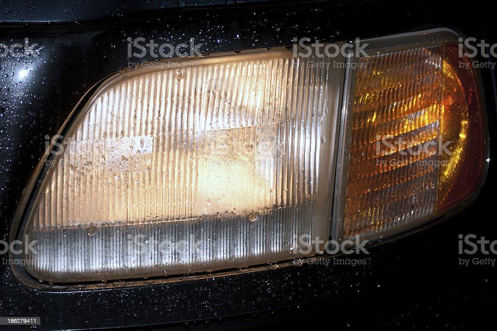 headlight by rain with water splash royalty-free stock photo