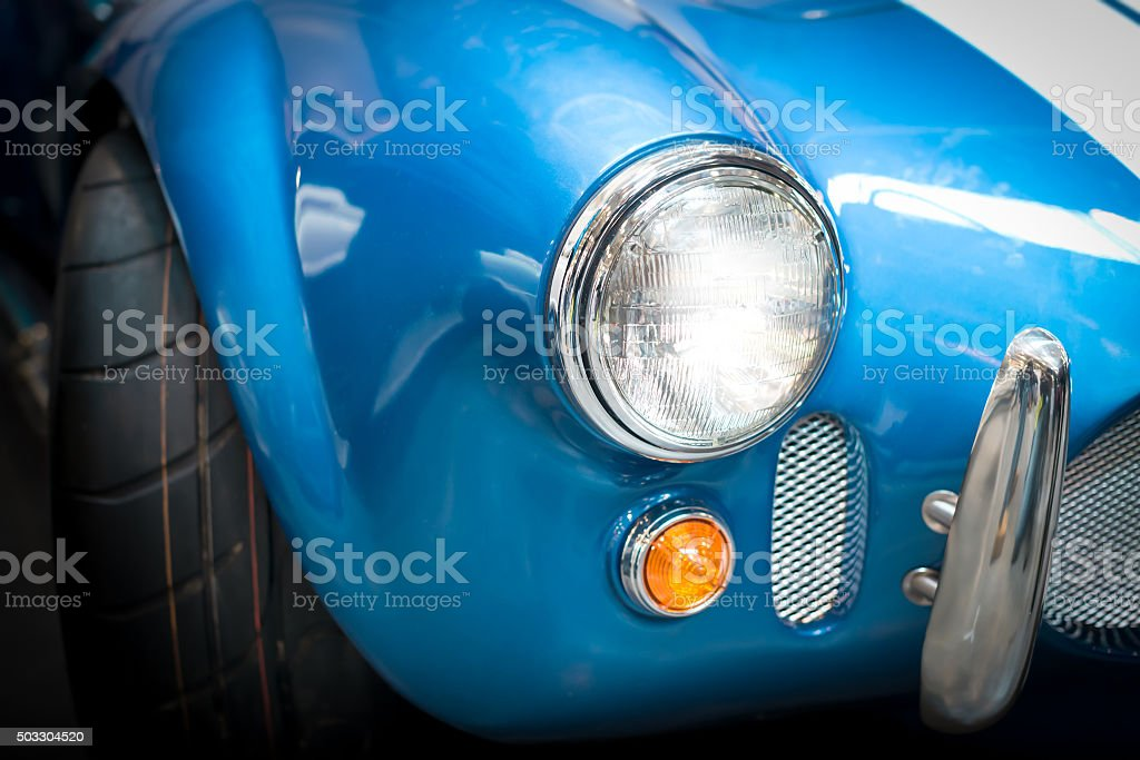 Headlight Detail of Blue Classic car stock photo