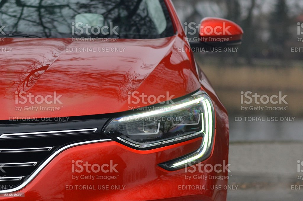 LED headlight in a new vehicle stock photo