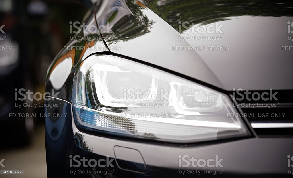 headlight of new black VW vehicle stock photo