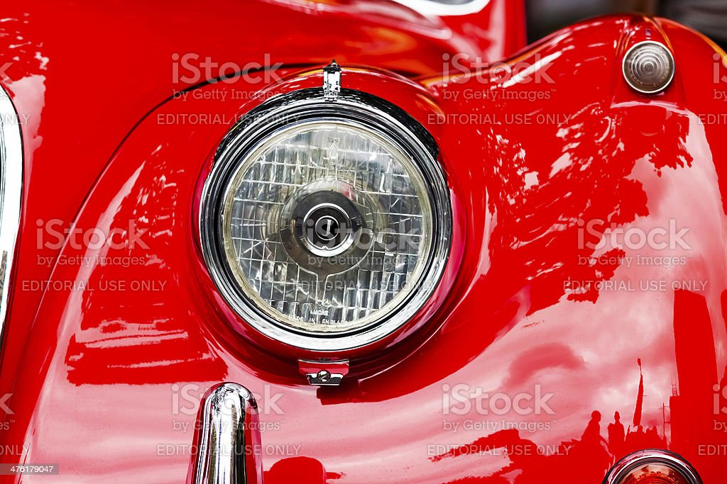 Headlight of red Jaguar stock photo