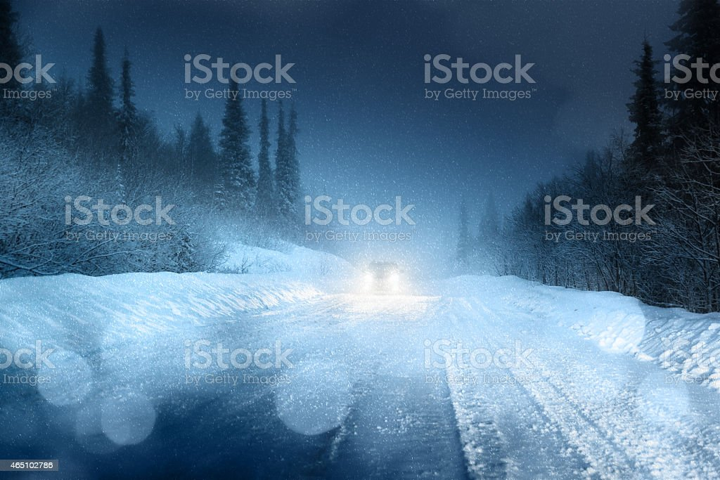Headlights on an icy winter road stock photo