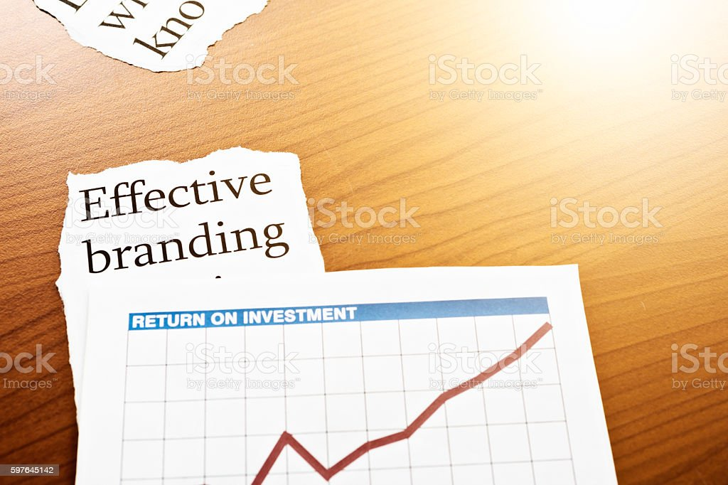 Headline 'Effective branding' by rising graph marked 'Return on Investment' stock photo