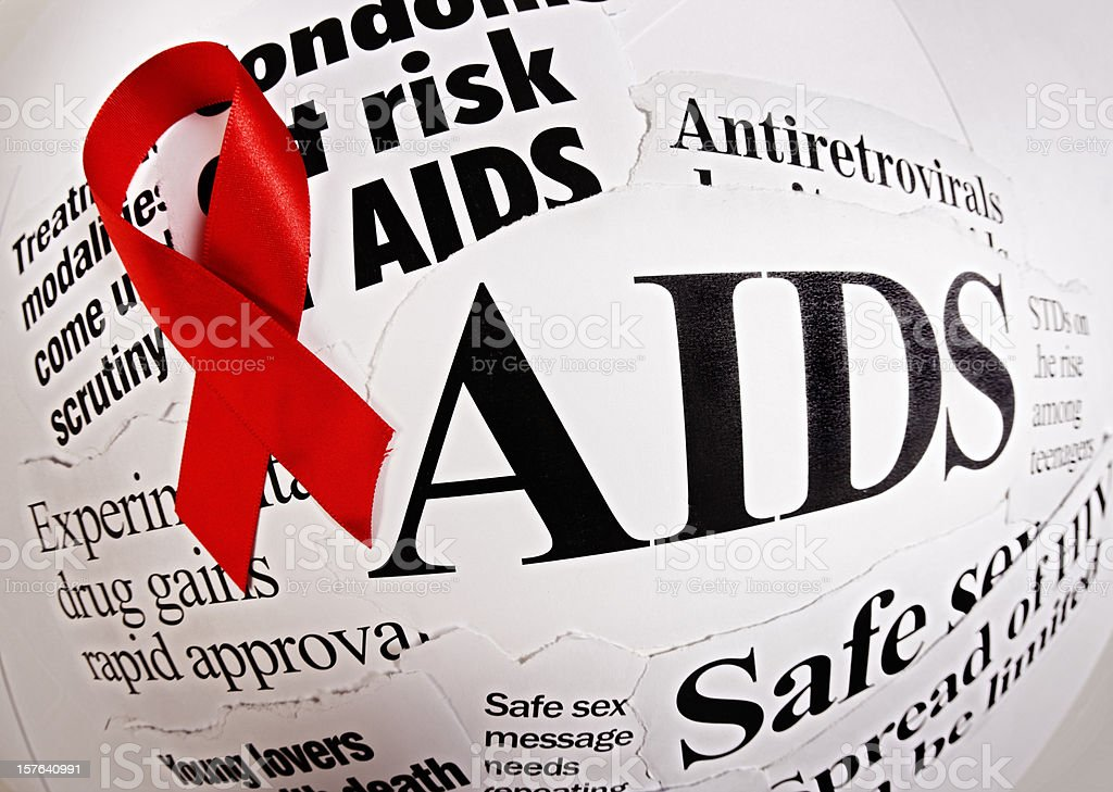AIDS headlines and red ribbon shot with fish eye lens stock photo