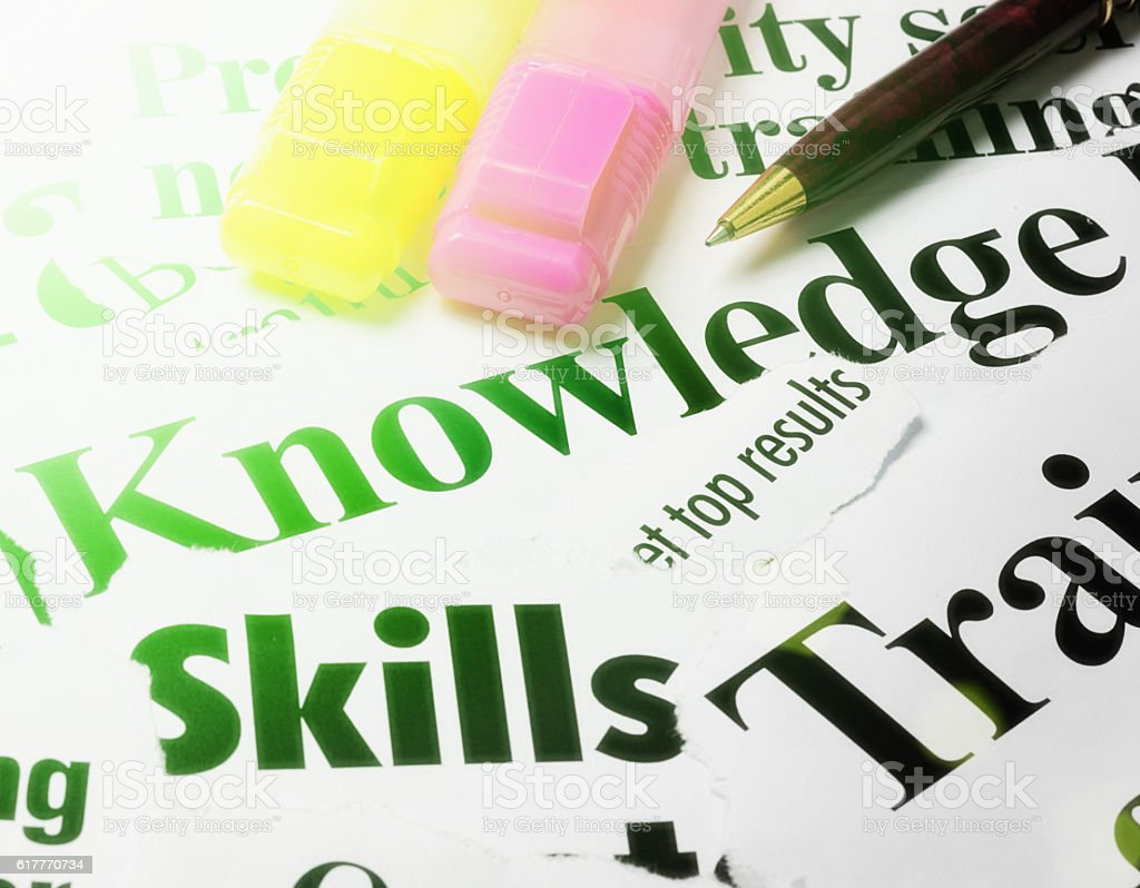 Headlines on knowledge, skills, and training with pens stock photo