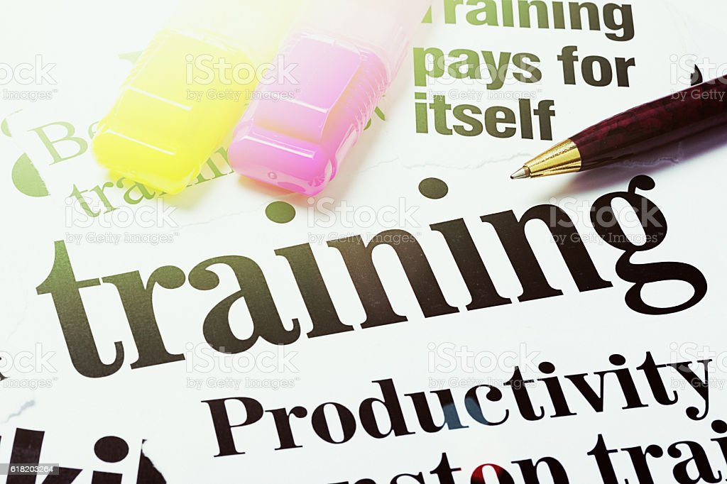 Headlines on the value of trainng for productivity with pens stock photo