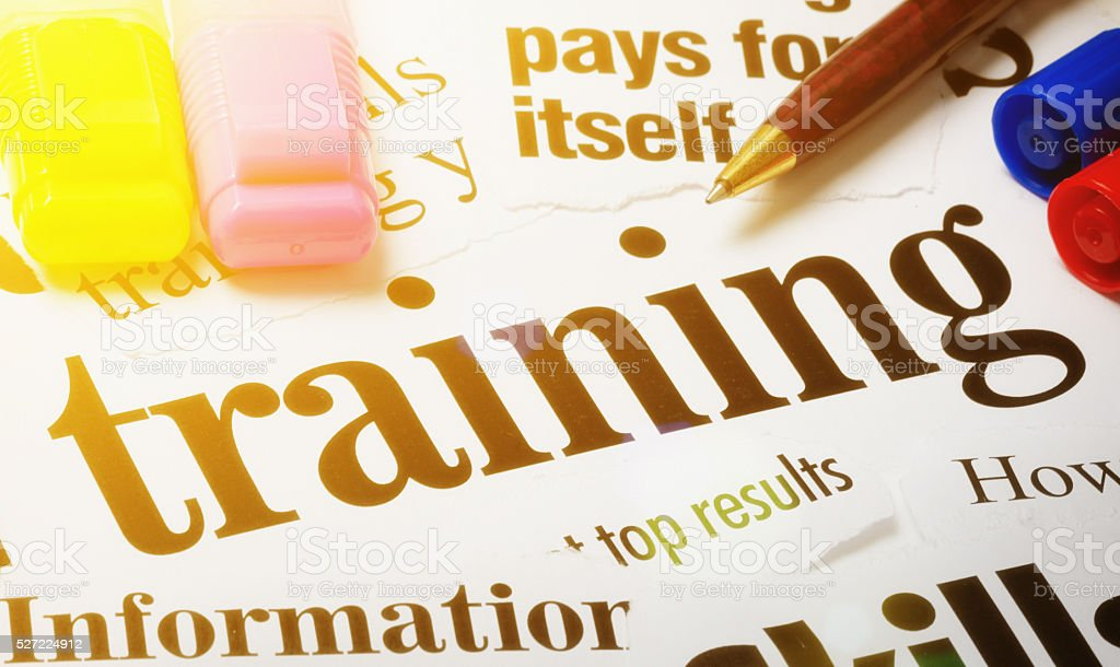 Headlines on Training and its value with selection of pens stock photo