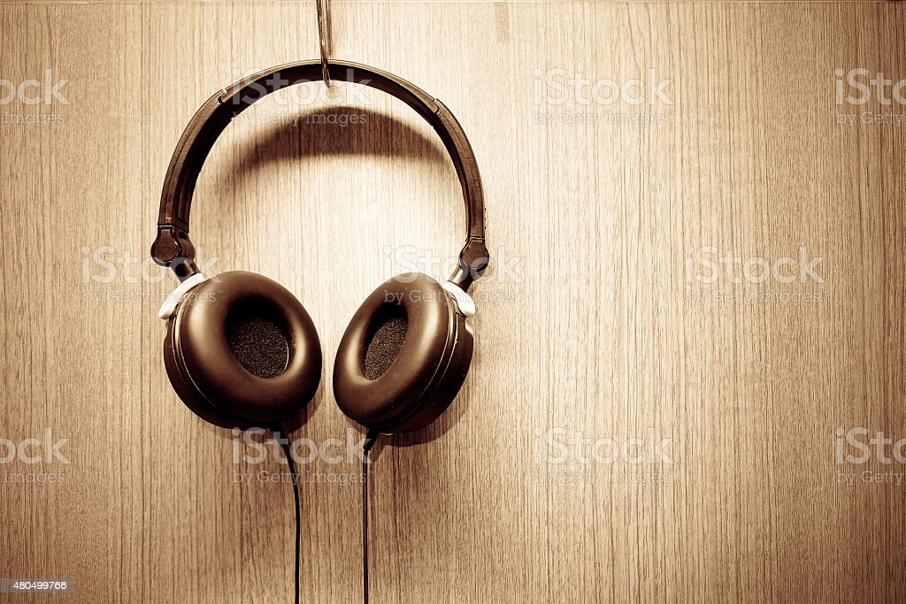 Headphone hanging on wooden wall stock photo