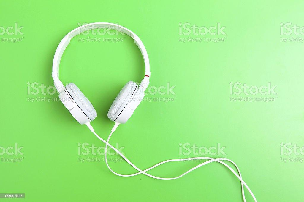 Headphone on green background royalty-free stock photo