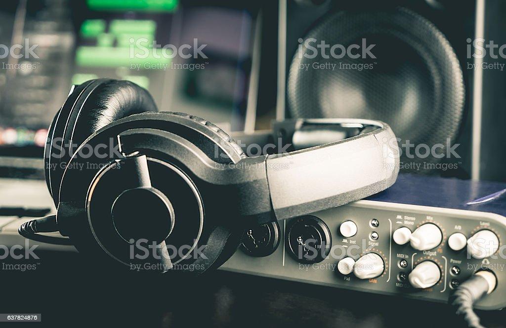 Headphone with other professional audio studio equipments. stock photo