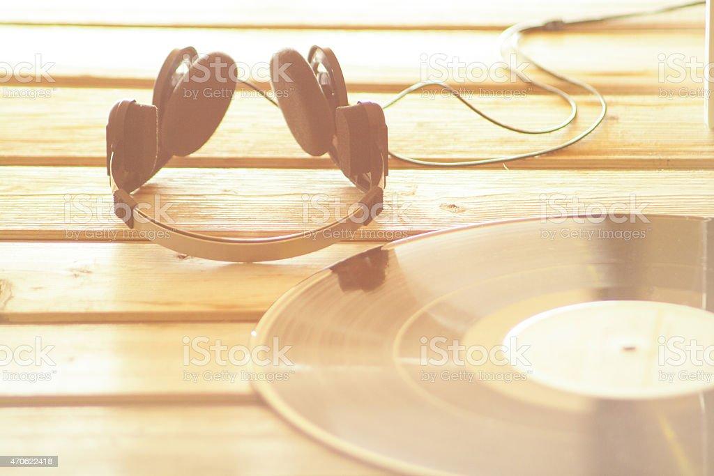 Headphones and vinyl record music background stock photo