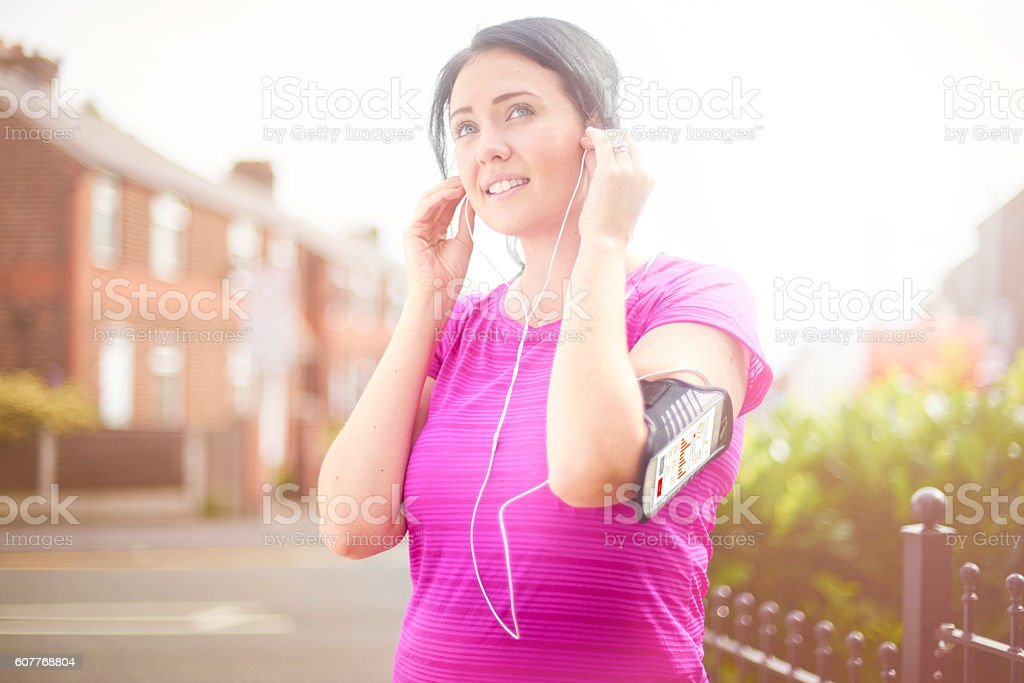 headphones in for the running stock photo