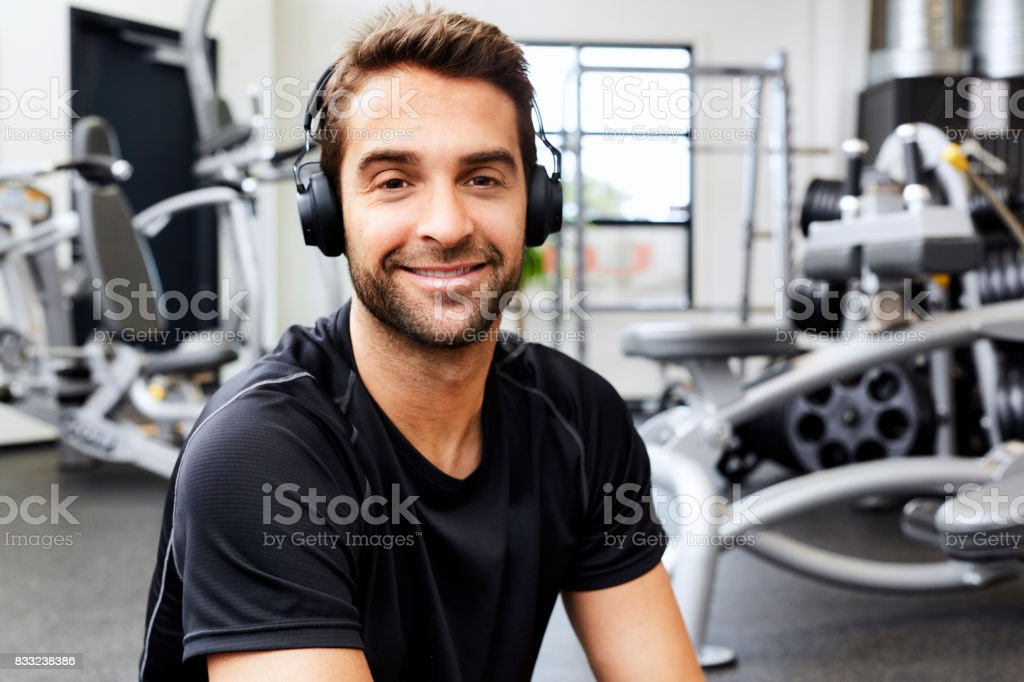 Headphones in gym stock photo