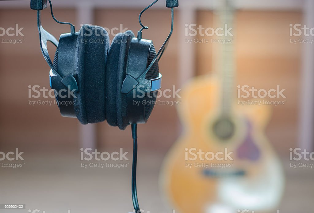 Headphones listen to music in room guitar background stock photo