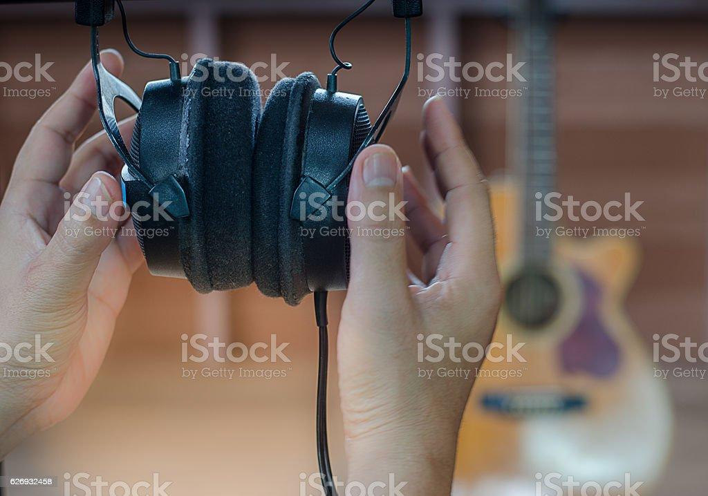 Headphones listen to music in room guitar background stock photo