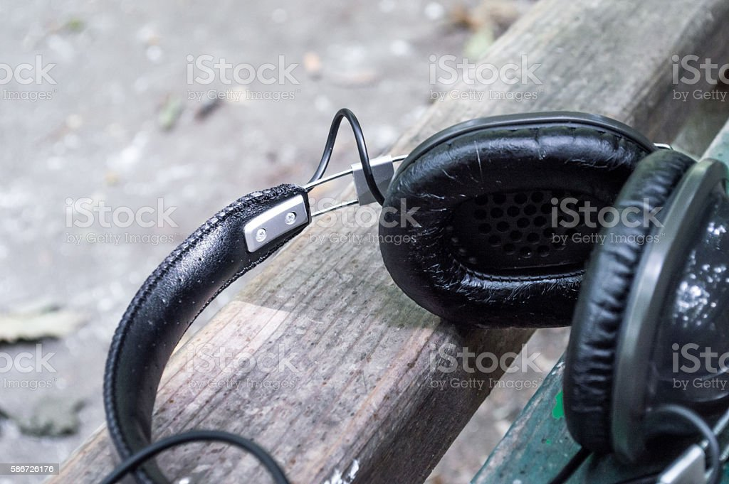 Headphones on a Park Bench Close Up royalty-free stock photo