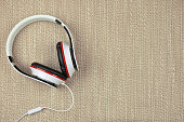 Headphones on a rough fabric background. Listen to music.