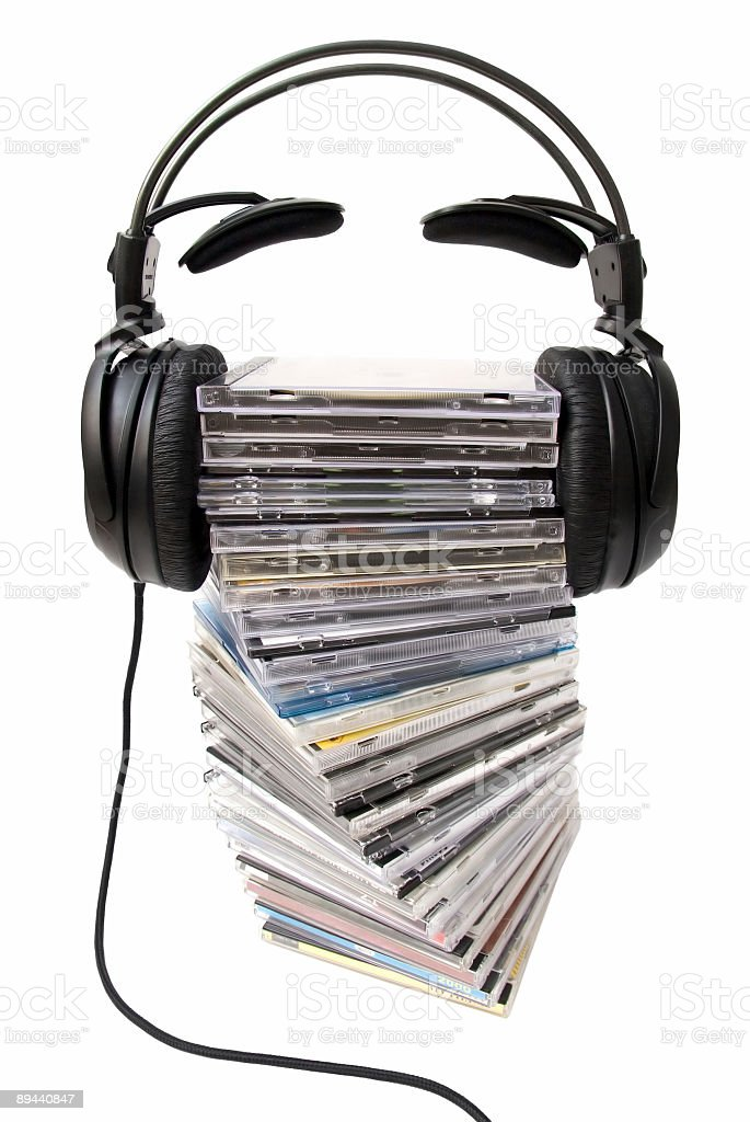 Headphones on cd heap front view stock photo