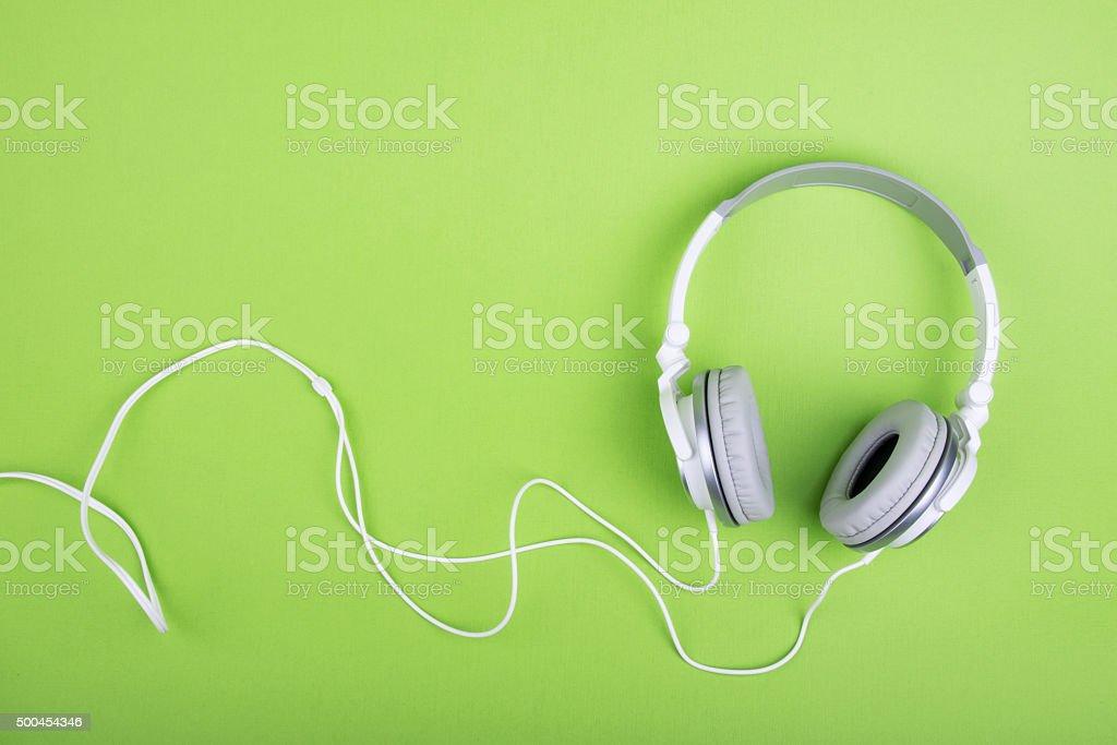 Headphones on green background stock photo