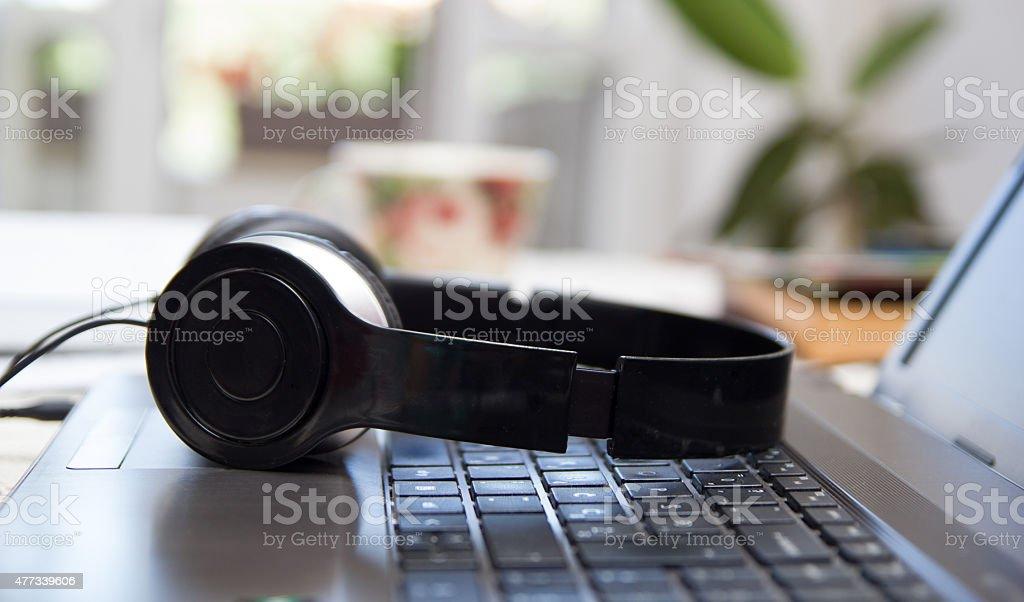 Headphones on laptop stock photo