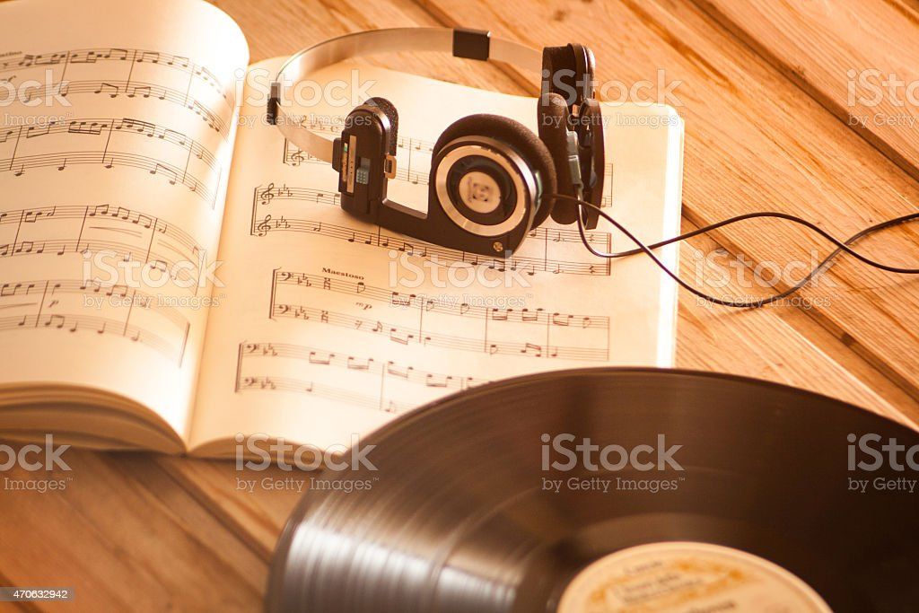 Headphones on music scores vinyl record music background stock photo