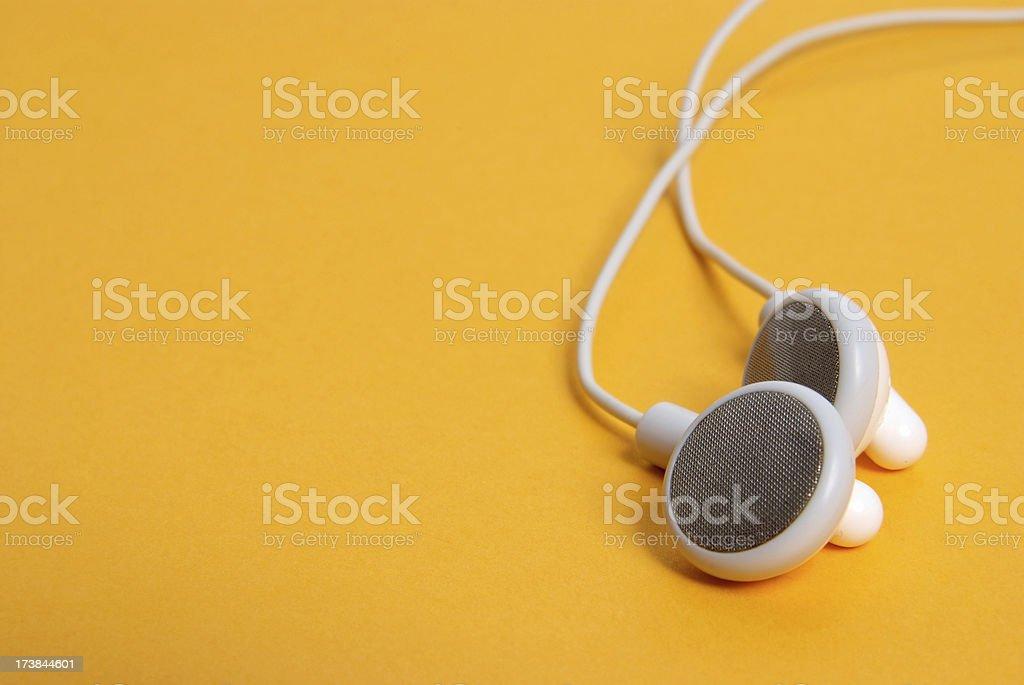 Headphones on orange stock photo