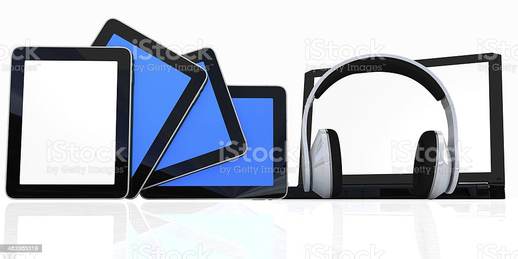 headphones on the  laptop and  tablet pc stock photo