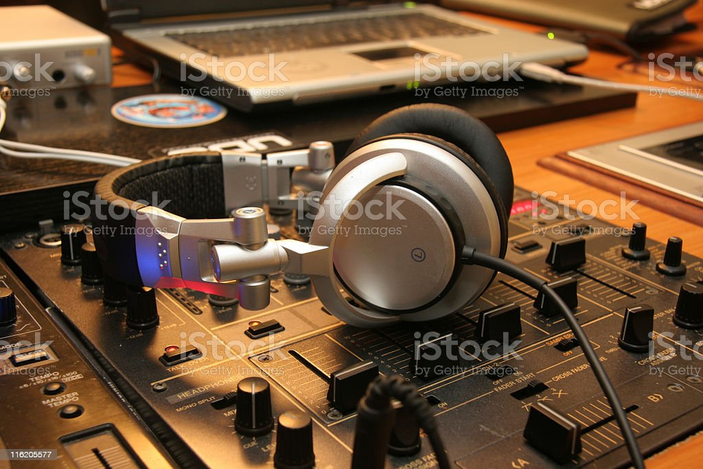 Headphones on top of a musical equipment royalty-free stock photo
