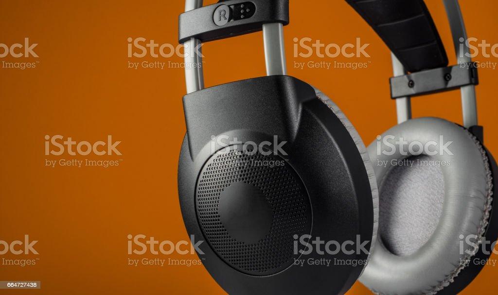 Headphones on yellow background stock photo
