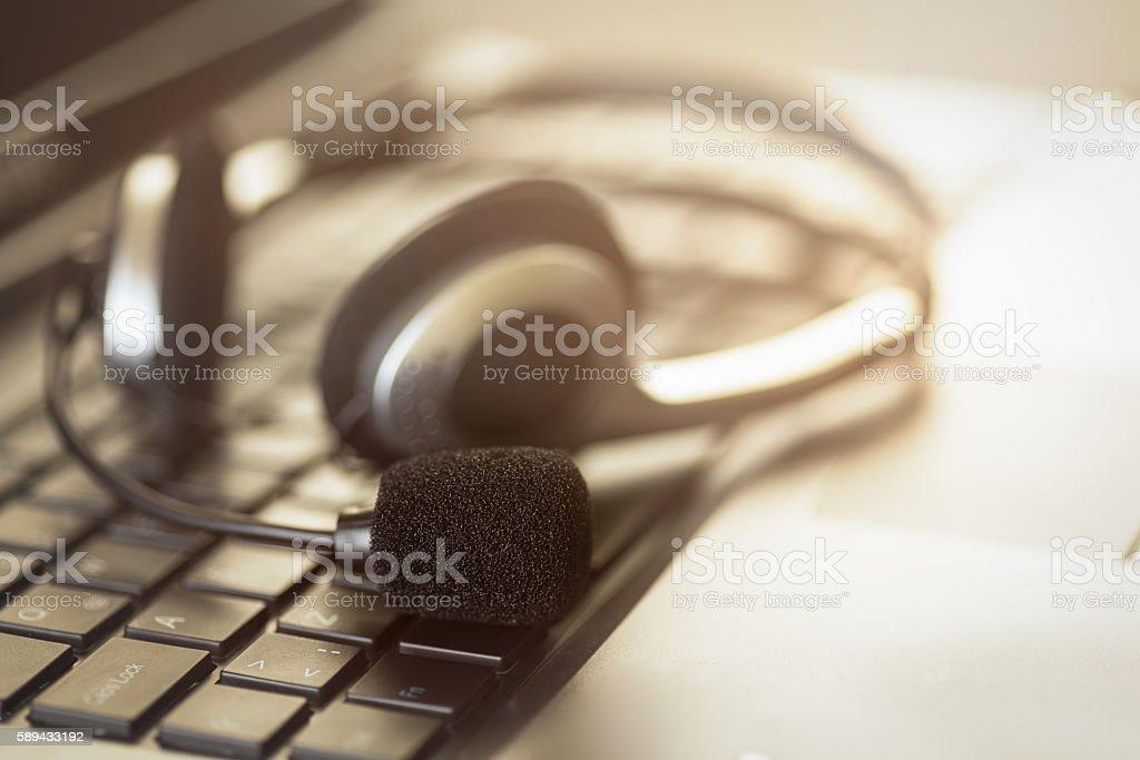 Headpset on laptop computer stock photo