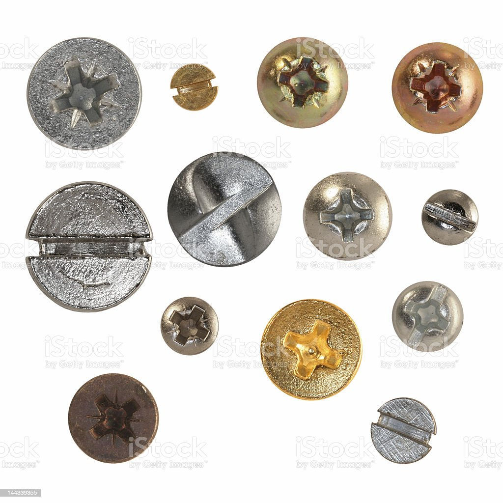 Heads of some metal nails and screws royalty-free stock photo
